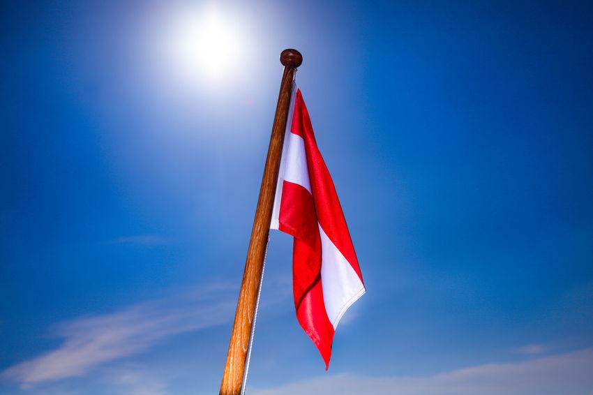 Austrian flag in the blue sky Austria Austrian Flag Boating Patriotism Austrian Banner Boat Boatflag Fahne Fahnenmast Flag Flagge Flagpole Flagstaff Navy Patriotismus Red White Red Rot Weiß Rot Sailing Schiffahrt Sea Ship Wind österreich Fahne