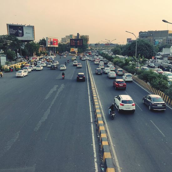 Noida Sector 18 Market Noida Market EyeEmAwards EyeEm Awesomely Oneplus6 Oneplus Office Building Yellow Taxi Elevated Road Highway Downtown District Rush Hour Traffic Jam Road Intersection Taxi