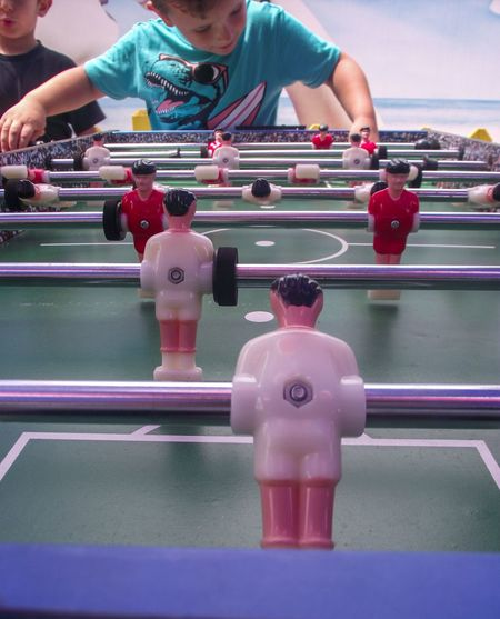 Boy Playing Foosball
