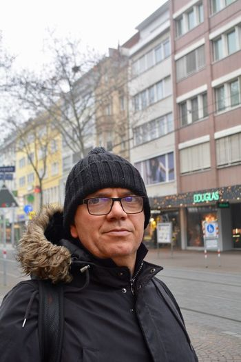 Portrait of mature man in city during winter