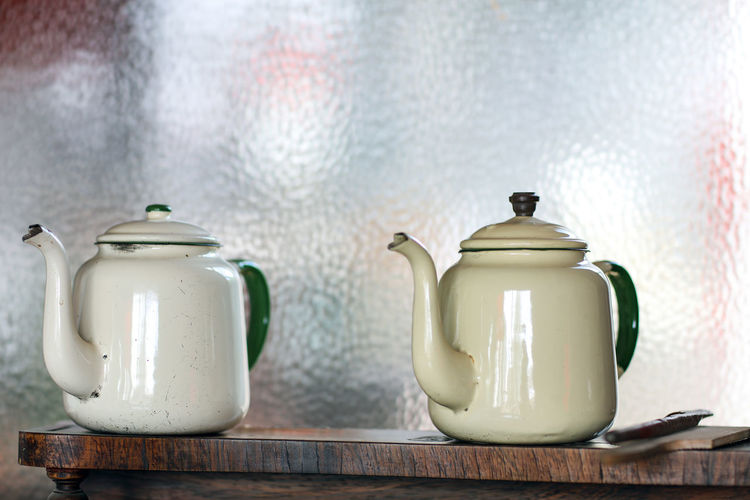Close-Up Of Teapots On Wooden Table