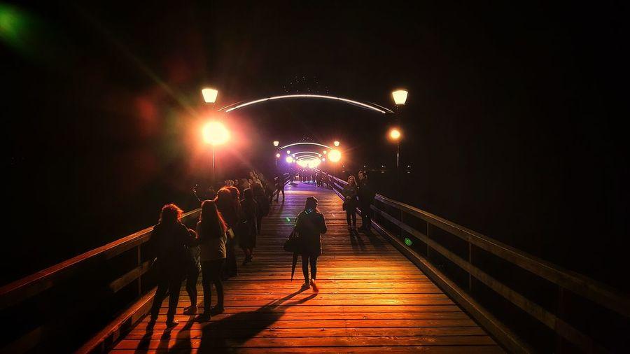 People On Footbridge At Night