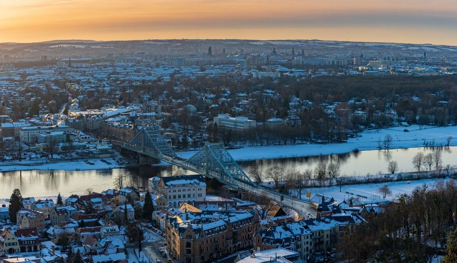 Blaues Wunder Blaues Wunder  Dresden Elbufer Elbe Warm Light Bridge Snow Winter Architecture City Built Structure Nature Building Exterior Cold Temperature Sky Water Sunset Cityscape Beauty In Nature Building Landscape