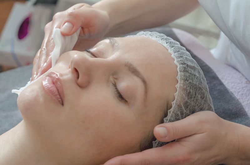 Close-up woman face in beauty spa on couch. relaxation, rejuvenation.