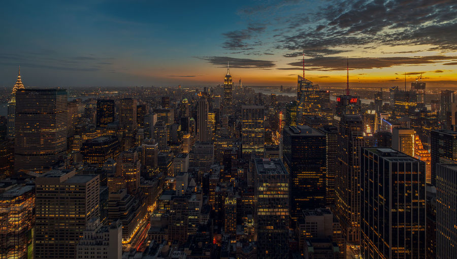 Aerial view of city lit up at night new york