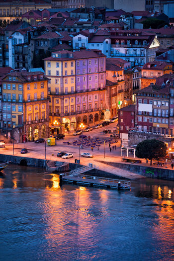 City of Porto in Portugal at night, Ribeira Square and historic houses by the Douro river in Old Town City Break Douro  Houses Old Town Porto Portugal Portuguese Square Travel Twilight Architecture Building Exterior Built Structure City Europe Evening Famous Place Historic Historical House Illuminated Night Ribeira River Water