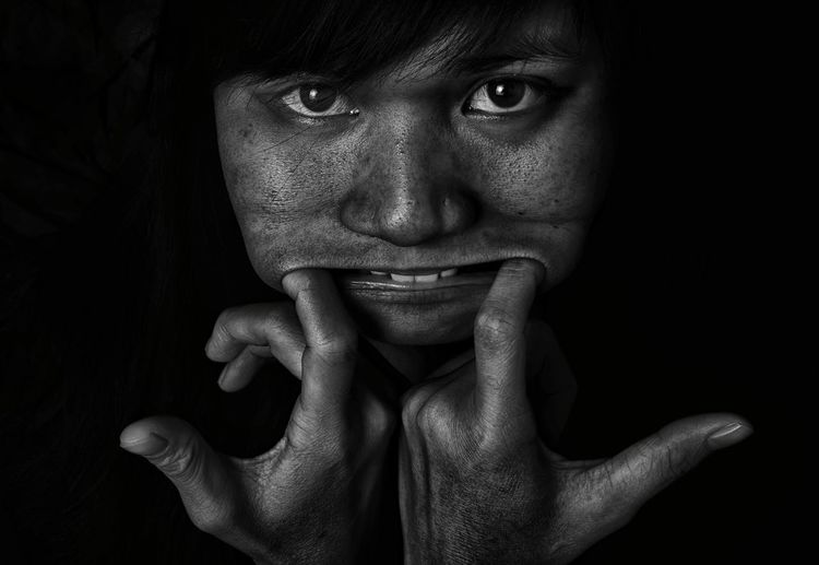 Close-Up Portrait Of Young Woman Making A Face
