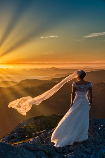 Bergen's Bride Sunset Sky Real People Women Beauty In Nature Lifestyles Scenics - Nature One Person Leisure Activity Nature Rear View Environment Standing Adult Full Length Dress Landscape Mountain Non-urban Scene Outdoors Wedding Wedding Photography Bride Capture Tomorrow