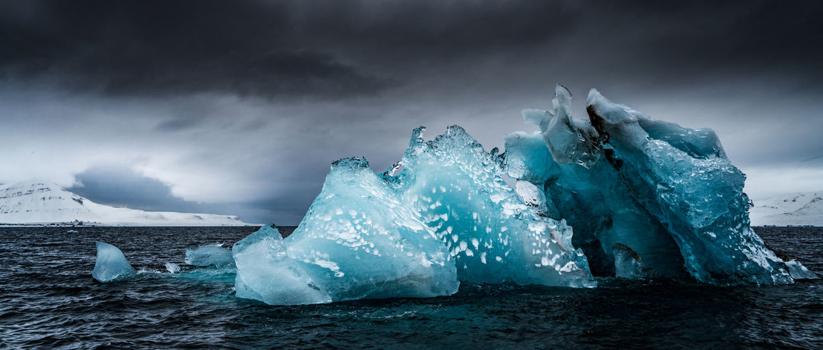 Beauty In Nature Cloud - Sky Cold Temperature Day Frozen Glacial Glacier Ice Iceberg Iceberg - Ice Formation Melting Nature No People Outdoors Scenics Sea Sky Snow Water Weather Winter