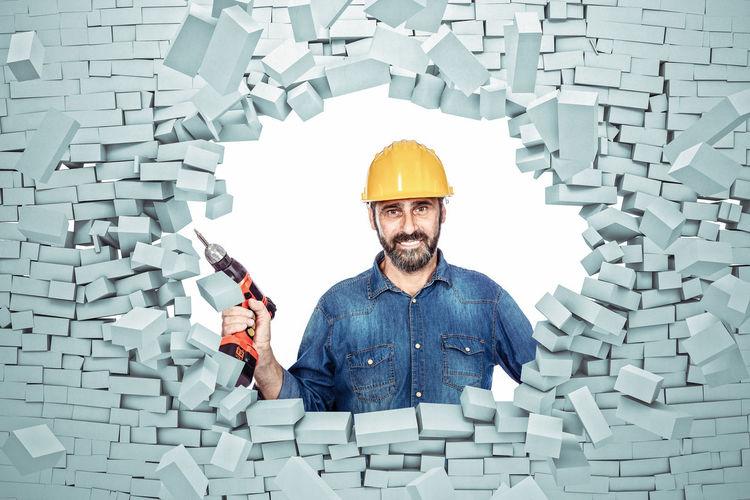 Handyman Worker Brick Explosion Service Explode Wall 3D Rendering Man Labor Repair Craftman Tools Smile Smiling Helmet Construction Denim 50s Bearded Beard Confident