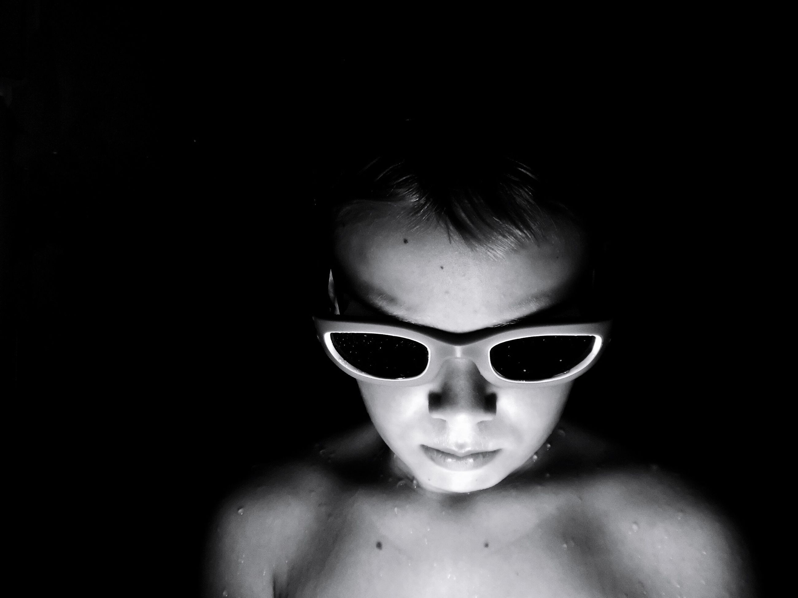 portrait, headshot, childhood, shirtless, boys, one person, child, front view, males, indoors, men, domestic room, copy space, lifestyles, real people, close-up, black background, innocence, dark