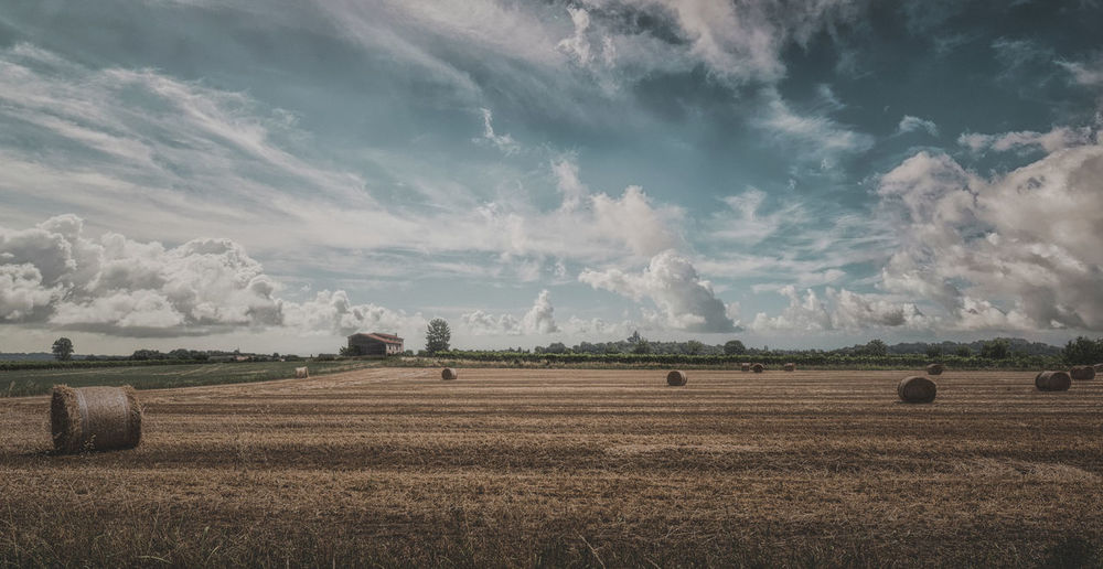 Agriculture Bale  Beauty In Nature Cloud - Sky Day Farm Field Hay Bale Landscape Nature No People Outdoors Rural Scene Scenics Sky Tranquil Scene Tranquility Tree