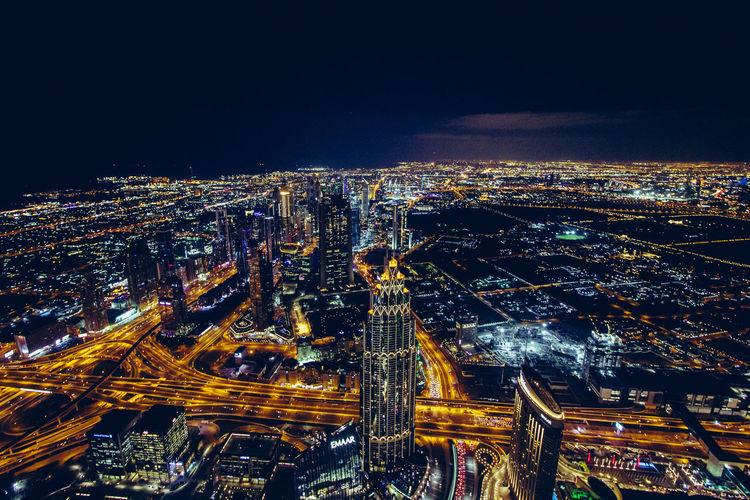 "View from ""Burj Khalifa"" at night. Building Exterior City Illuminated Architecture Night Building Modern City Life Cityscape Dubai Dubai Skyline Dubai Night Nightphotography Nightlife Night View Night Lights Skyscraper Sky Dubai Burj Khalifa Burj Khalifa Tall - High Outdoors Travel Destinations Tourism Modern No People"