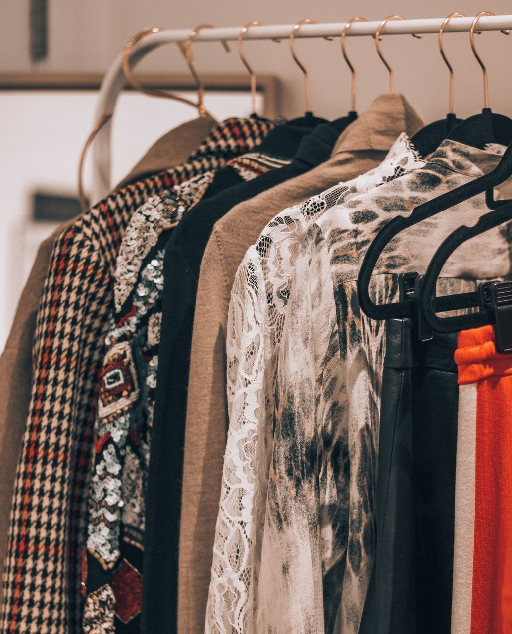 clothing, coathanger, hanging, rack, fashion, no people, indoors, textile, focus on foreground, furniture, clothes rack, variation, choice, close-up, retail, closet, still life, dress, for sale, collection, menswear, jeans, womenswear