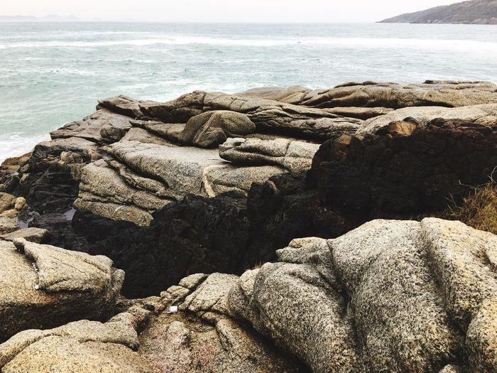 Rocks on beach by sea
