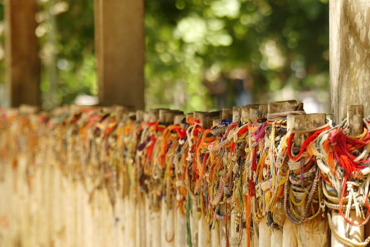 Close-up of bracelets hanging outside temple