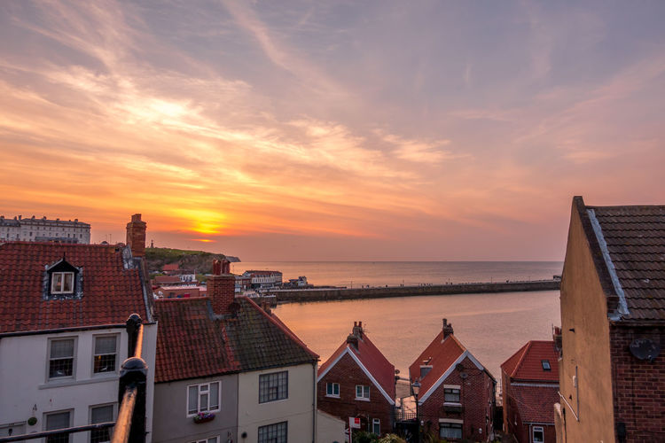 Whitby Whitby Abbey Whitby Harbour Whitby View Whitby North Yorkshire Whitby Pier Sunset Sky No People Building Row House Building Exterior Seaside Coast Coastal North Yorkshire Fishing Village Cloud - Sky Travel Destinations Outdoors House Roof Residential District Architecture Water