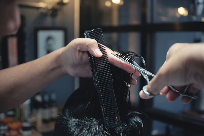 Arts Culture And Entertainment Barber Barber Shop Close-up Combing Customer  Cutting Hair Expertise Fashion Focus On Foreground Hair Care Hairbrush Holding Human Body Part Human Hair Human Hand Indoors  Lifestyles Occupation Real People Selective Focus Skill  Small Business Two People Working