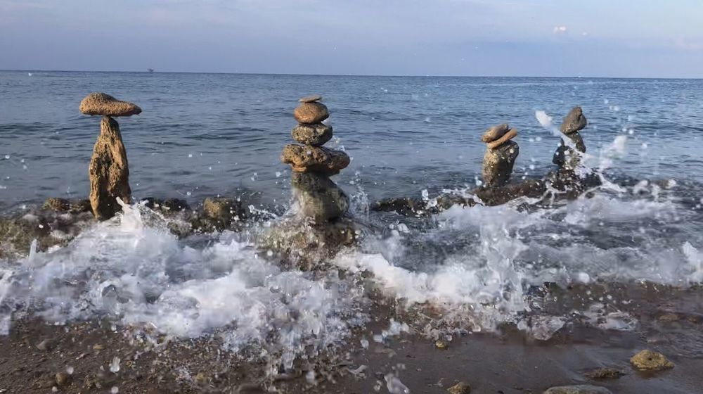 Stone balancing Water Sea Horizon Over Water Horizon Motion Sky Scenics - Nature No People Sport Tranquil Scene Land Day Wave Beauty In Nature Solid Beach Nature Splashing Outdoors Rock