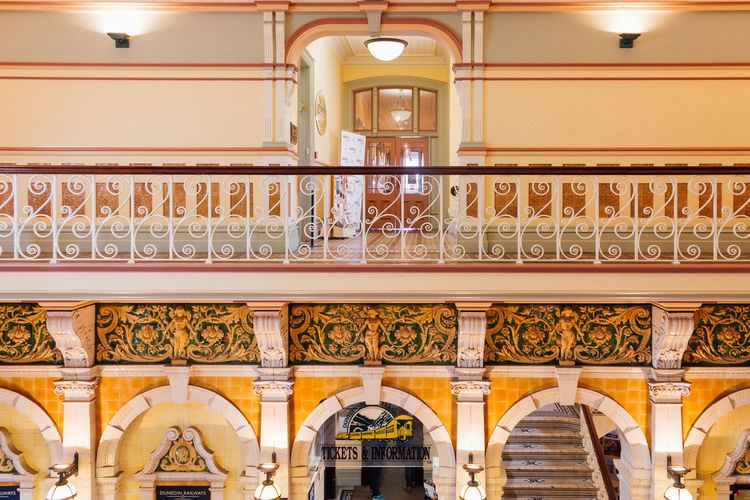 Inside the Dunedin Railway Station Architectural Column Architecture Balcony Banister Day Golden Handrail  Indoors  Interior No People Railing Railway Station