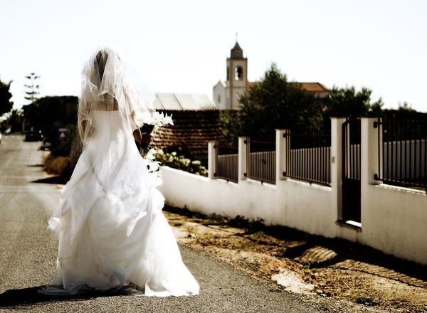 Bride walking alone to church Backgrounds Bride Church Churches Day One Person People Real People See From Behind Sky Tree Walking Wedding Dress Women