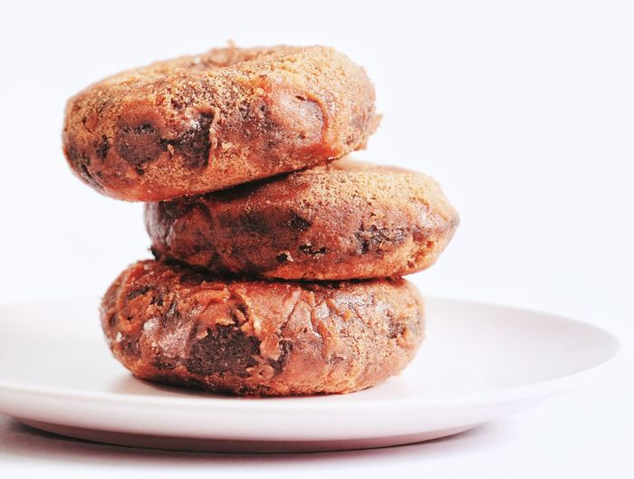 Close-up of cookies in plate against white background