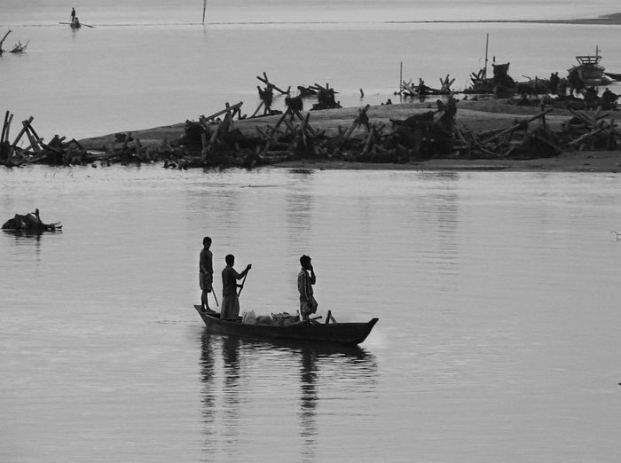 boat life! Black & White Black And White Blackandwhite Blackandwhite Photography Boat Daily Life Eye For Photography EyeEm EyeEm Best Shots EyeEm Gallery EyeEm Nature Lover EyeEmBestPics Fisherman Lifestyles Medium Group Of People Mode Of Transport Nature Outdoor Photography Outdoors People River River Crossing Water