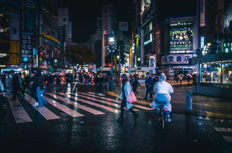 People On Street During Rainy Season At Night