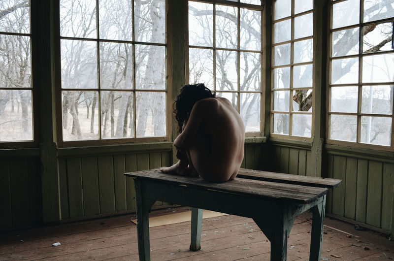 Home Interior Seat Rear View Leisure Activity Shirtless Adult Depression - Sadness Glass - Material Real People Lifestyles Window One Person Indoors  Day Sitting Transparent Full Length Nature Nüde Art. Nude_model Nudeblackandwhite Nude-Art Nudeartphotography Abandoned Naked_art My Best Photo International Women's Day 2019