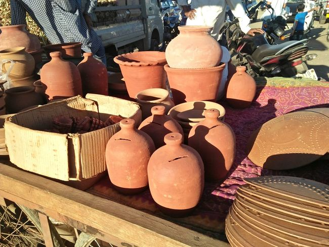 utensils Clay Pot Clay Pot Maker Clay Pottery Clay Pottery Pieces Retail  For Sale Earthenware Small Business Market Container Variation Shelf Store Merchandise Business Finance And Industry Large Group Of Objects Indoors  No People Close-up Market Stall Day Clay Choice Workshop