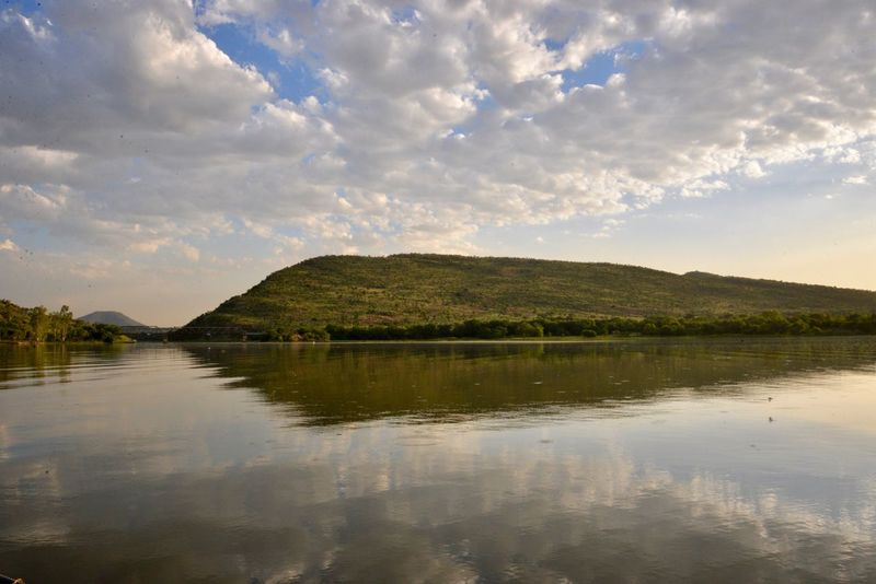 Reflection on water Reflection Water Sky Lake Nature Scenics Tranquil Scene Tranquility Waterfront Cloud - Sky No People Outdoors Beauty In Nature Hartebeespoort Hartbeespoort Dam Wall Hartbeespoort Dam Hartbeespoort Harties Day Mountain