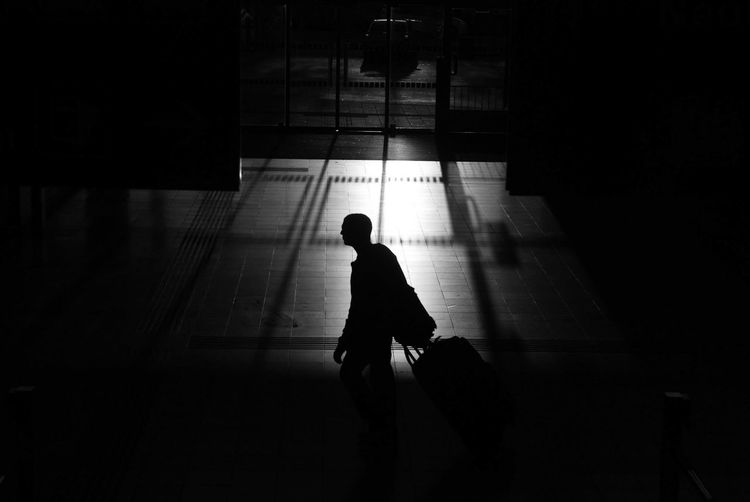 Voyage Travel Streetphotography Cityscape Urbanphotography Urban Perspectives Building Exterior Shadows & Lights Building Interior Urban Train Station Travel Destinations Travel Photography Streetphoto_bw Silhouette One Person Transportation City Lifestyles Men Real People on the move Unrecognizable Person Motion