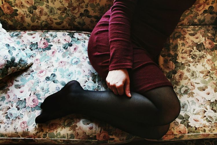 Low section of woman on sofa