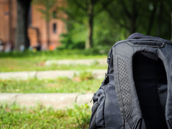 Close-up of backpack on field