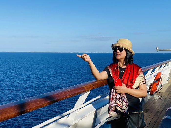 Full length of woman against sea against sky