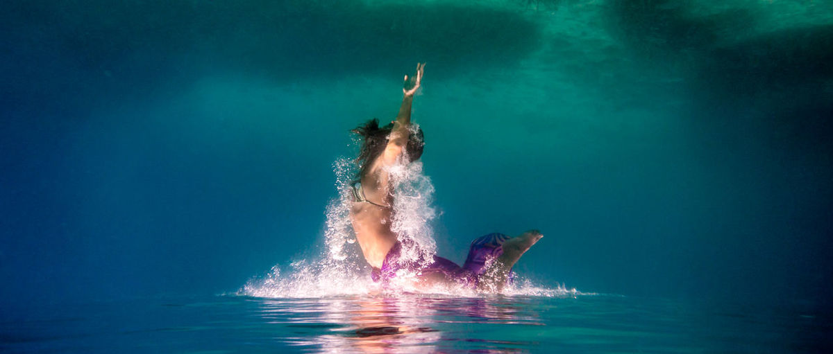 Side View Of Woman Swimming Underwater