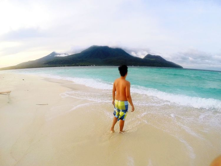 Beach Sea Vacations Full Length Shirtless Rear View One Person Sand Wave Outdoors People Leisure Activity Cloud - Sky Day Nature Water Sky Adult Snorkeling Only Men Camiguin Camiguin Philippines Camiguin White Island White Island