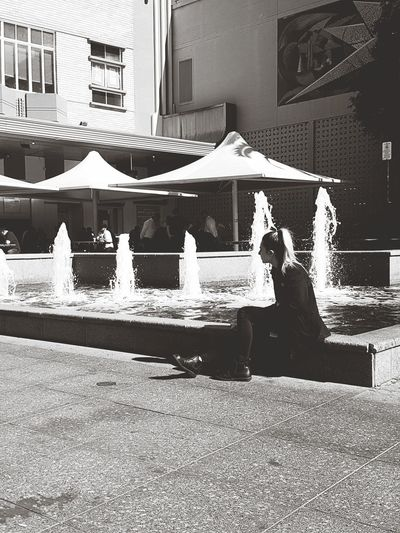 She sat.. I captured.. She left.. Water LifestylesEyeEm Best Shots Architecture Adult Modern EyeEmBestPics EyeEmNewHere Women Around The World Innocent Architecture People Outdoors Day Real People Building Exterior Adult One Person City Adults Only