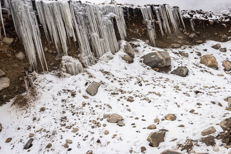 High angle view of frozen waterfall on rocks