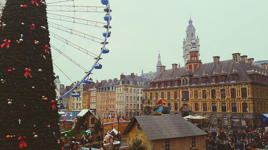 City Sky No People Outdoors Day Christmas Market Clock Tower Cultures Celebration Built Structure Architecture Arts Culture And Entertainment Christmas Ball Christmas Christmas Decorations Christmas Tree Building Exterior Belgium City Travel Destinations Ferris Wheel Statue Belgique Belgium