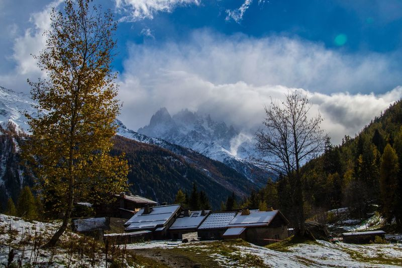 trelechamps,chamonix,haute savoie,france Tree Sky Plant Mountain Cloud - Sky Nature Architecture Scenics - Nature Day Beauty In Nature Built Structure Mountain Range Snow Forest Building Exterior No People Cold Temperature Land Winter Outdoors Change Snowcapped Mountain