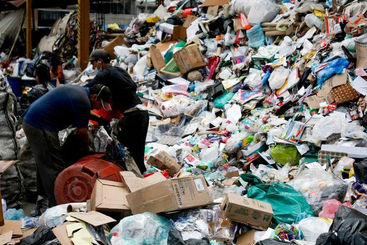 Men Collecting Garbage