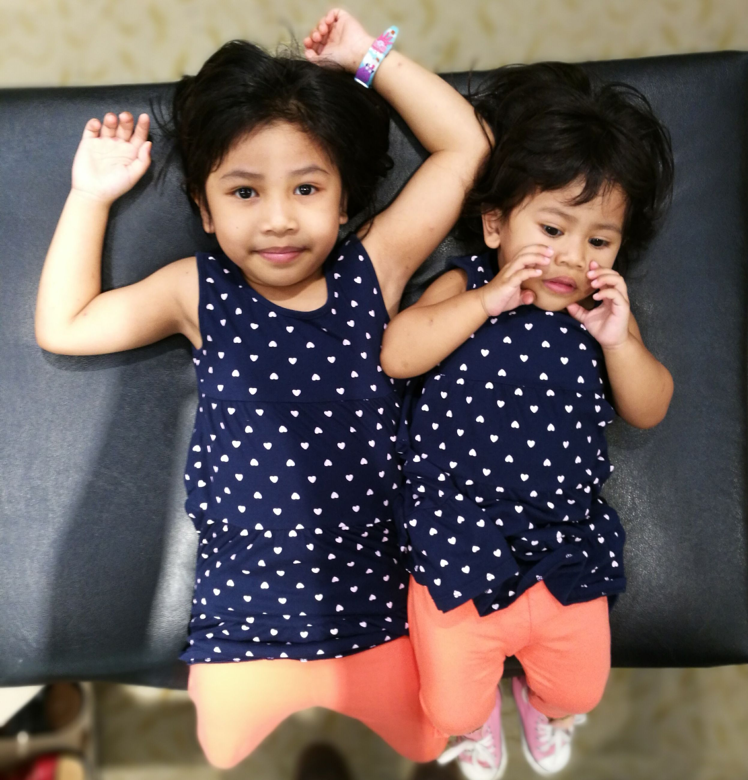 childhood, child, girls, cute, two people, children only, innocence, portrait, looking at camera, lifestyles, friendship, togetherness, cheerful, smiling, bonding, people, indoors, real people, close-up, day