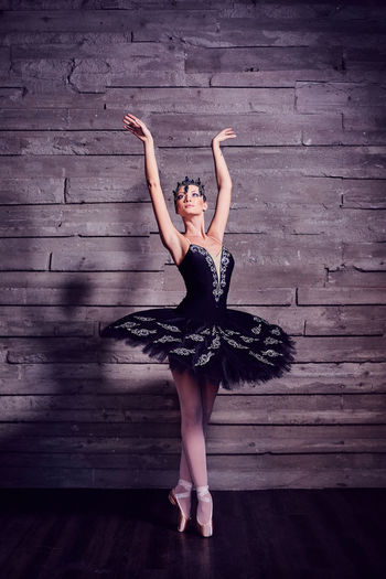 Ballerina in a beautiful costume Arms Raised Balance Ballet Ballet Dancer Ballet Shoe Beautiful Woman Beauty Dancing Elégance Full Length Human Arm Indoors  One Person Real People Skill  Standing Teenager Tiptoe Tutu Women Wood Young Adult Young Women