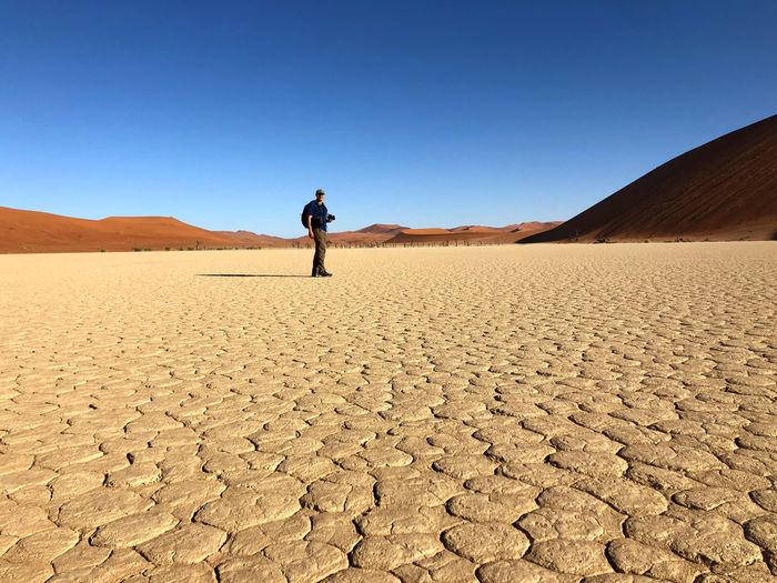 Full length of man on desert against clear sky