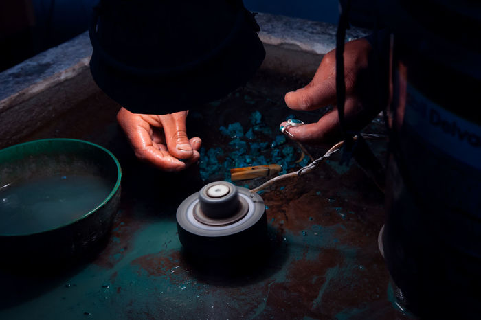 Taller de platería artesanal. Valle Sagrado. Perú Plata Cusco Artesania Artesanos Tradición Real People Hand Human Hand One Person Holding Men High Angle View Working Human Body Part Occupation Skill  Preparation  Indoors  Industry Craft Workshop Container Making Day Finger