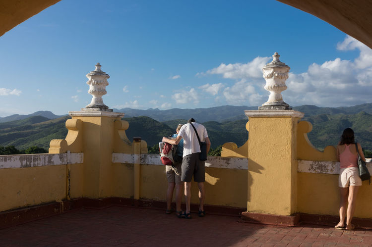 Trinidad: Tourists enjoying the view from the roof terrace Adults Only Arch Clouds And Sky Cuba Cuba Collection Day Lookout Mountain Outdoors People Rear View Religion Roof Roof Terrace Sky Travelling Photography UNESCO World Heritage Site Young Adult