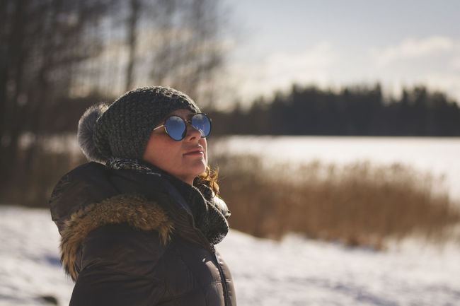 Freezing Nature Reflection Sweden Winter Caucasian Cold Day Focus On Foreground Lifestyles Light And Shadow Nature One Person Outdoors People Portrait Portrait Photography Real People Sunglasses Warm Clothing Woods Young Adult Young Women