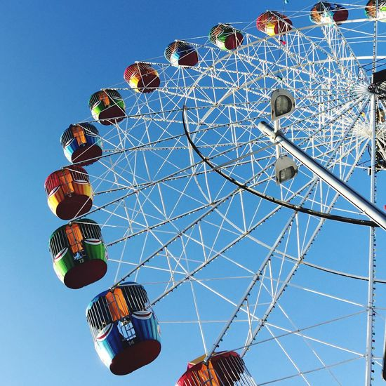 What goes up Ferris Wheel Blue Sky At The Fair Fairground Spring Fair Urban Geometry Colour Lookingup