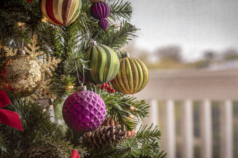 Christmas background with light bulbs and Christmas decorations on the pine tree Decoration Celebration Holiday Christmas Christmas Decoration Tree Christmas Ornament christmas tree Plant Sphere No People Event Holiday - Event Close-up Hanging Religion Nature Ball Ornate Christmas Backgrounds Bulbs Tree